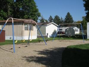 Lamplighter Village in Brookings, SD - Swing set