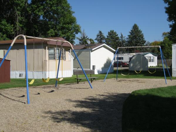 Lamplighter Village in Brookings, SD - Swing set