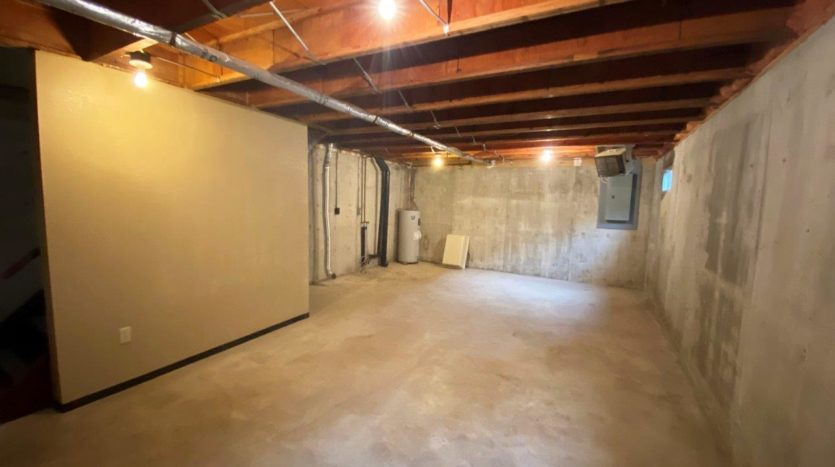 Colony West Townhomes in Watertown, SD - Basement with Washer and Dryer Hookups