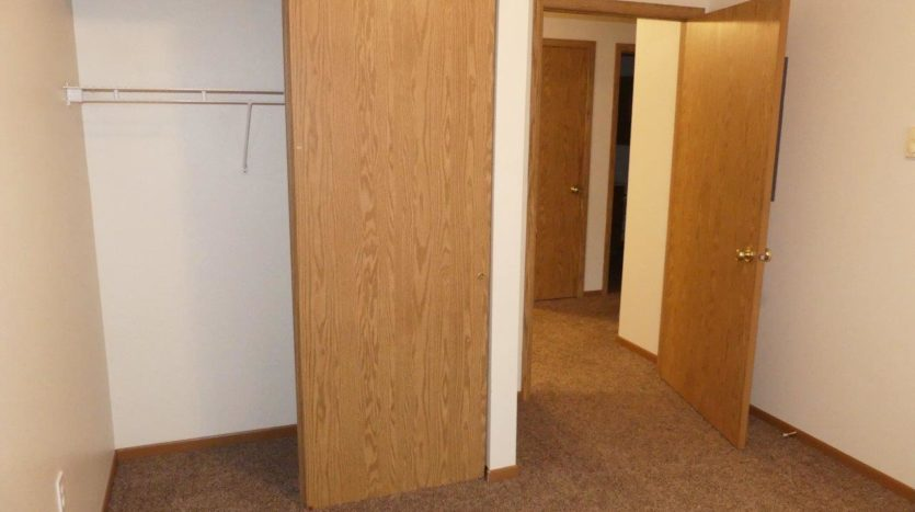 Sand Creek Apartments in Volga, SD - 1st Bedroom Closet