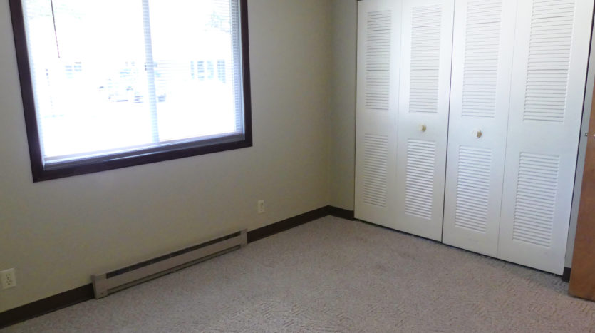 Friendship Village Senior Apartments in Dell Rapids, SD - Bedroom Closet View