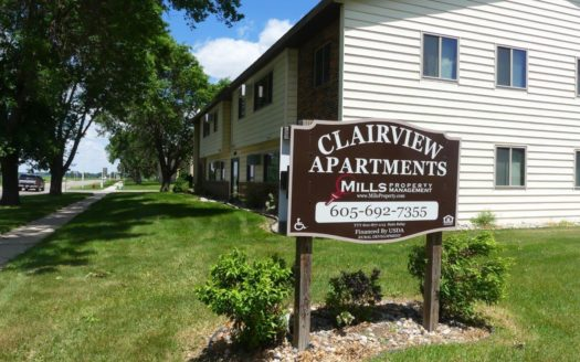 Clairview Apartments in Brookings, SD - Property Sign with Building Exterior