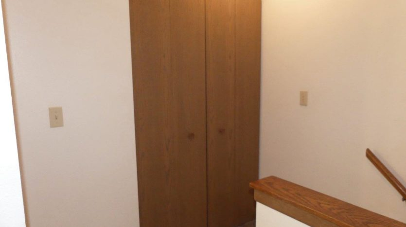 Pheasant Valley Courtyard Townhomes in Milbank, SD - Closet Off Stairs