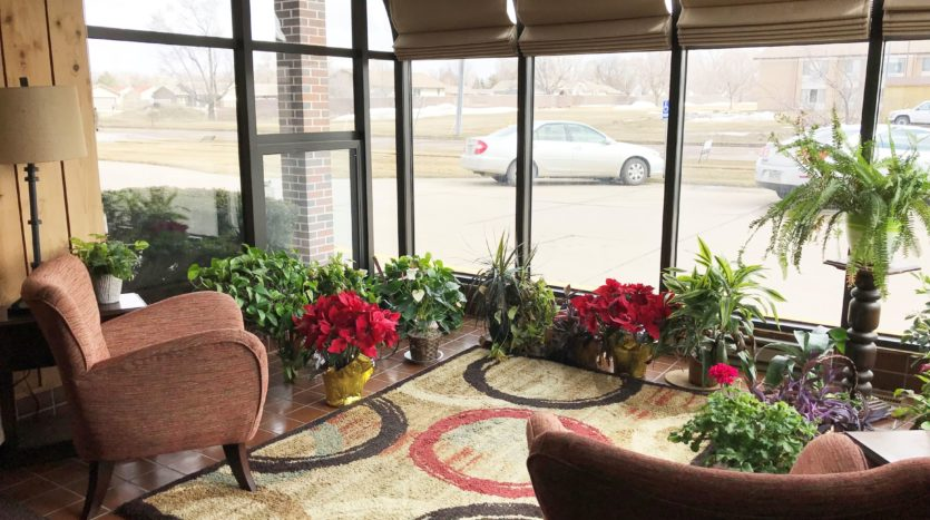 Courtyard Apartments in Huron, SD - Community Sun Room