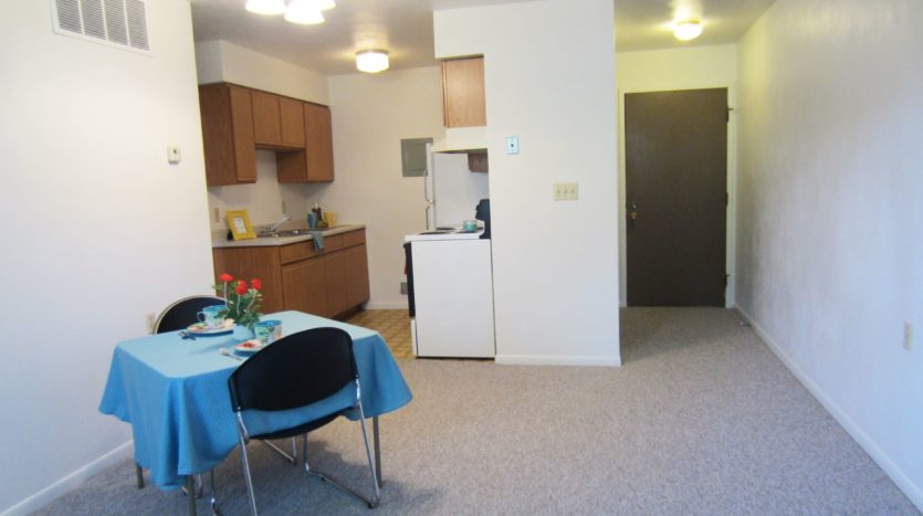 Village Green Apartments in Yankton, SD - Dining to Kitchen View