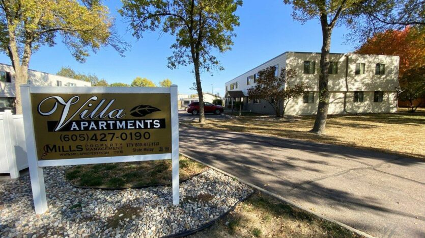 Canton Villa Apartments in Canton, SD - Property Sign and Exterior