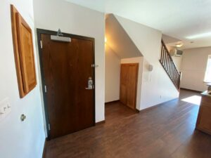 Downtown Lofts in Brookings, SD - 1 Bed Apartment Front Door and Storage