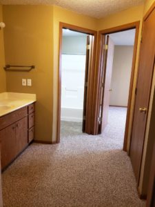 Three Oaks II Townhomes in Watertown, SD - Hallway with Vanity