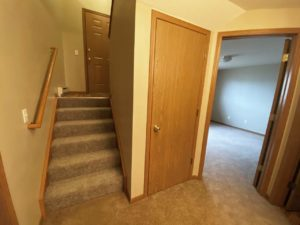 Springwood Townhomes in Watertown, SD - Lower Level Stairs and Storage