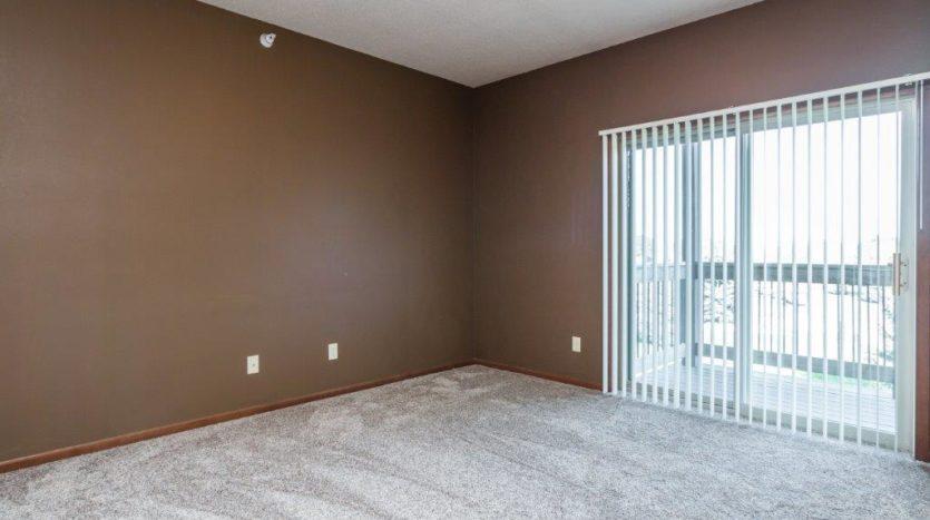 Mills Ridge Apartments in Brookings, SD - Patio Door