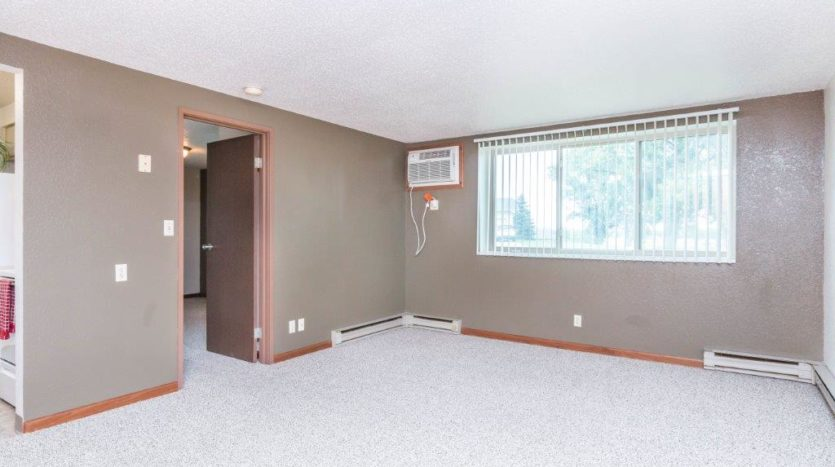Onaka Village Apartments in Brookings, SD - Accent Paint in Living Room