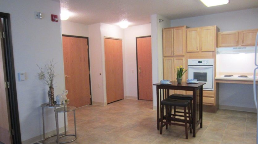 Pheasant Run Apartments in Brookings, SD - Kitchen and Front Entrance