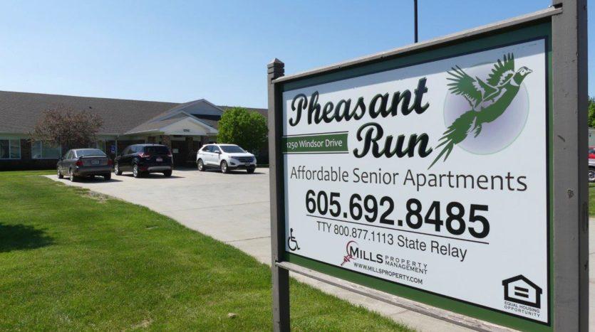 Pheasant Run Apartments in Brookings, SD - Exterior Sign