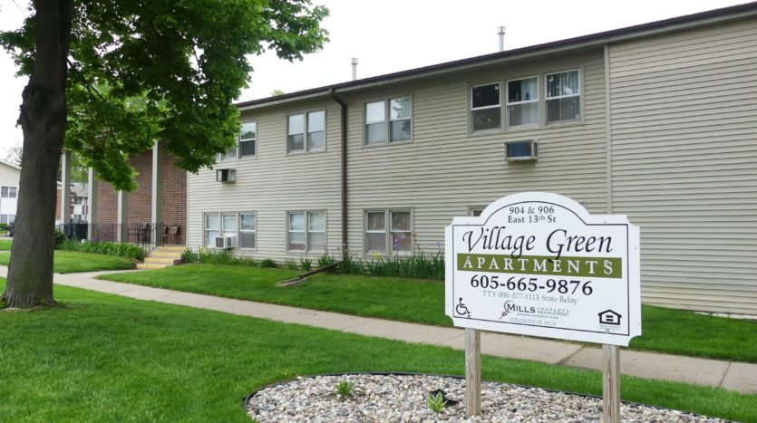 Village Green Apartments in Yankton, SD - Property Sign