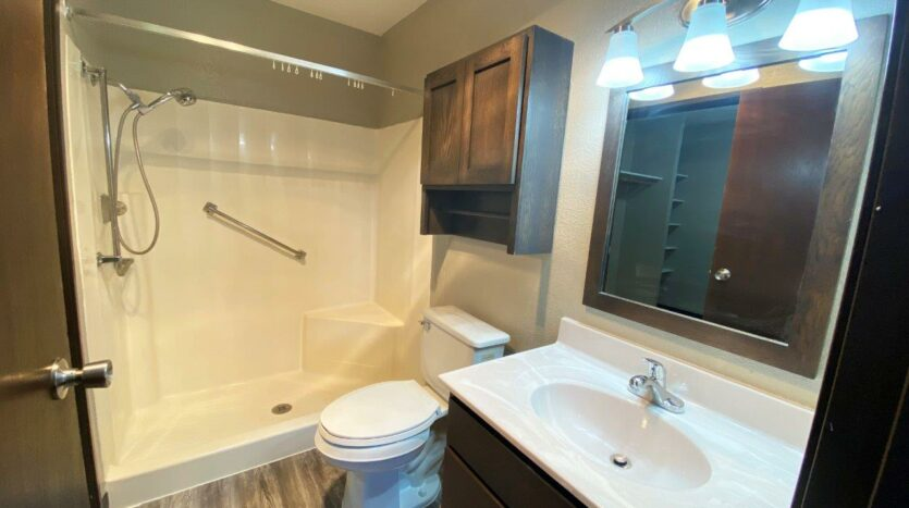 Arrowhead Apartments in Brookings, SD - Updated Apartment Bathroom