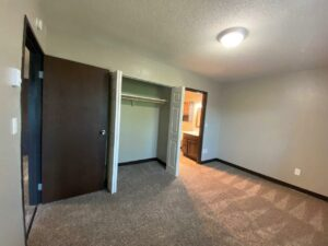 Arrowhead Apartments in Brookings, SD - Updated Apartment Bedroom Closet