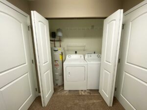 Copperleaf Townhomes in Mitchell, SD - Laundry in Master Closet