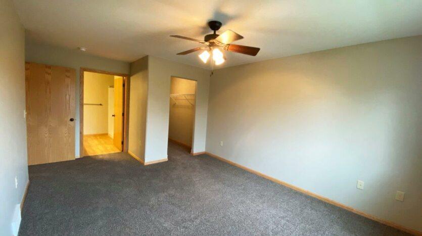 Tiyata Place Apartments in Brookings, SD - Master Bedroom Closet and Bathroom Views