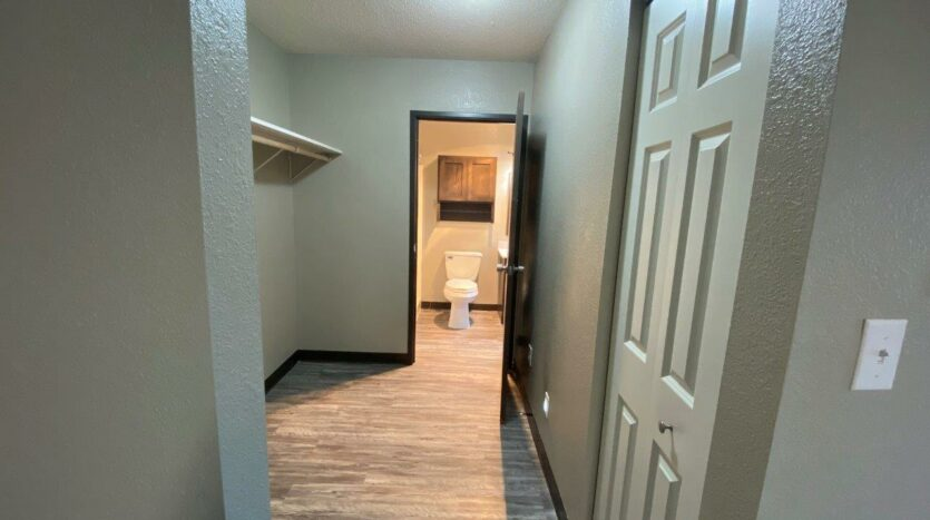 Arrowhead Apartments in Brookings, SD - Updated Apartment Storage Hallway