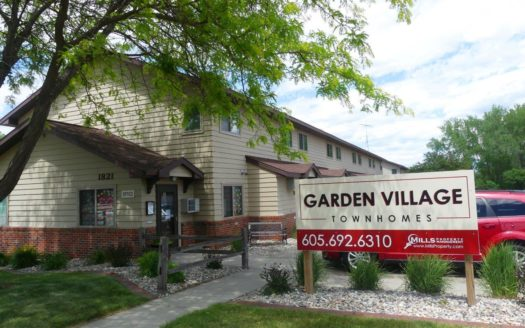 Garden Village Townhomes in Brookings, SD - Property Sign and Exterior