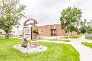 Village Square Apartments in Brookings, SD - Sign