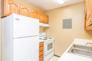 Village Square Apartments in Brookings, SD - Alternate Kitchen Layout Fridge View