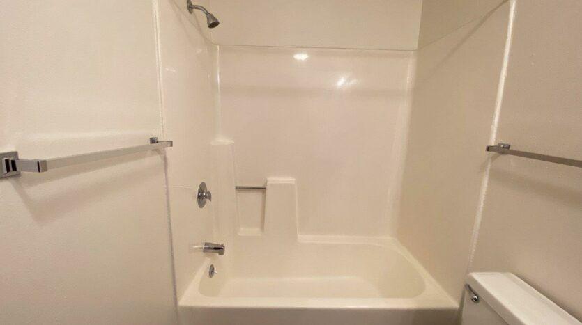 Autumn Grove Apartments in Mitchell, SD - Bathroom Bathtub and Shower