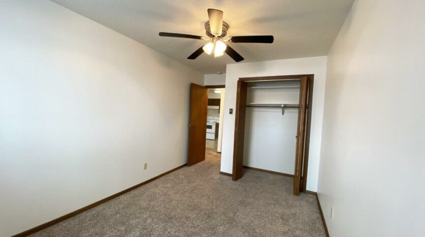 Autumn Grove Apartments in Mitchell, SD - Bedroom Closet