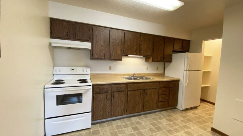 Autumn Grove Apartments in Mitchell, SD - Kitchen and Pantry