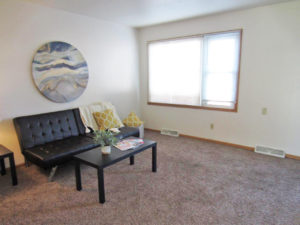Palace Apartments & Townhomes in Mitchell, SD - 2 Bedroom Apartment Living Room2