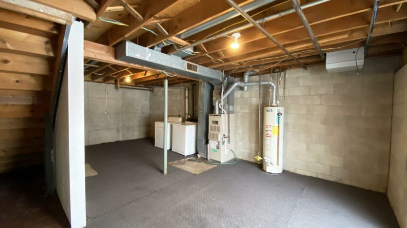 Palace Apartments & Townhomes in Mitchell, SD - 2 Bedroom Townhome Unfinished Basement with Laundry