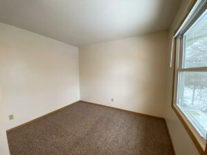 Palace Apartments & Townhomes in Mitchell, SD - 2 Bedroom Townhome Bedroom 1