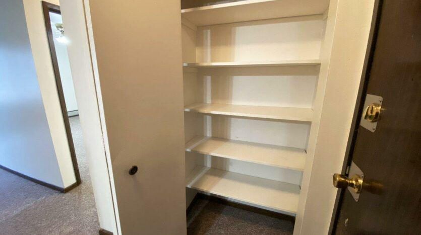 Palace Apartments & Townhomes in Mitchell, SD - 1 Bedroom Apartment Front Closet