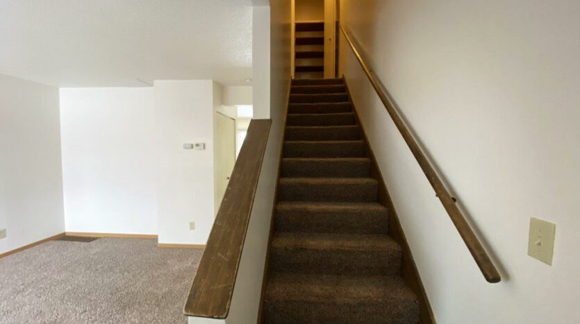 Palace Apartments & Townhomes in Mitchell, SD - 2 Bedroom Townhome Staircase