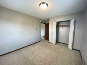 Northland Court Apartments in Mitchell, SD - Alternative 2 Bed Bedroom 1 Closet