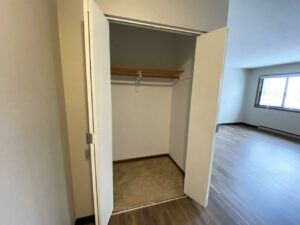 Northland Court Apartments in Mitchell, SD - 2 Bed Front Closet