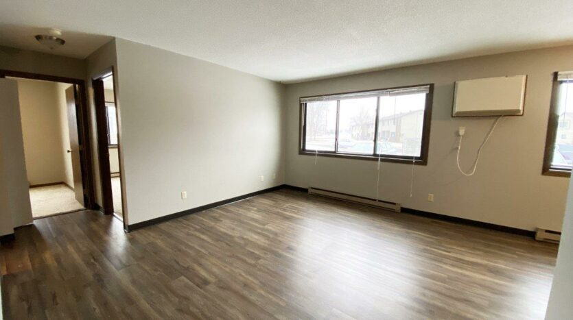 Northland Court Apartments in Mitchell, SD - Living Room and Hallway