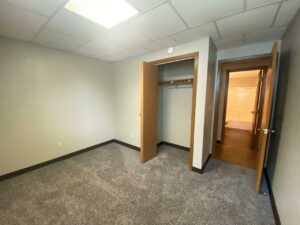 Prairie Circle Apartments in Brookings, SD - Lower Level Apartment Bedroom 1 Closet