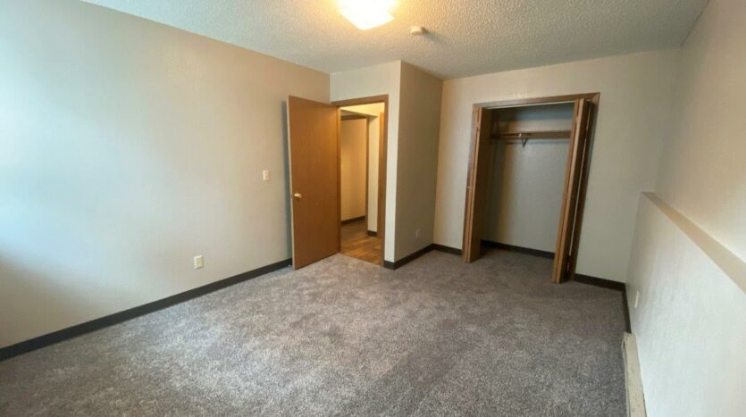 Prairie Circle Apartments in Brookings, SD - Lower Level Apartment Bedroom 2 Closet