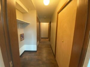 Prairie Circle Apartments in Brookings, SD - Lower Level Apartment Hallway