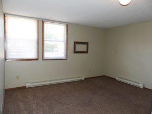 Hill Center Apartments in Salem, SD - Living Area (Studio Apartment)