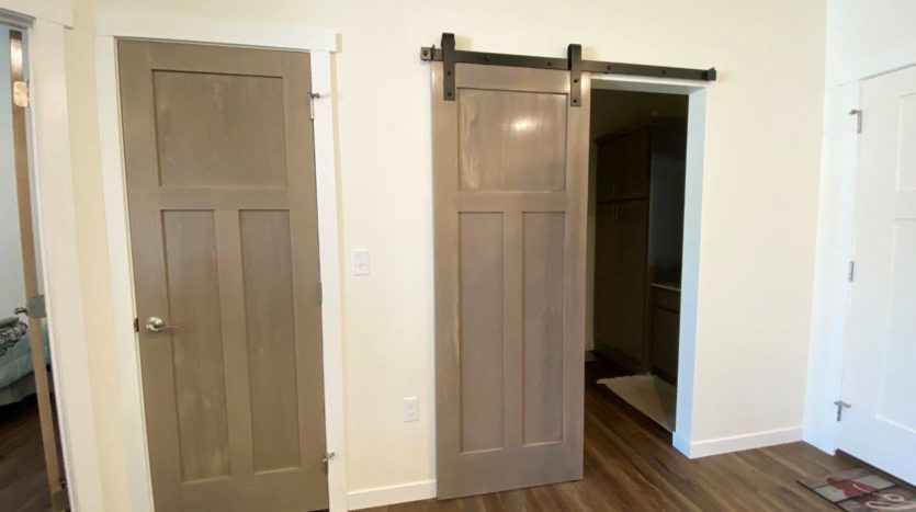 Lake Area Townhomes Phase IIB in Madison, SD - 1 Bedroom Closet and Bathroom Door