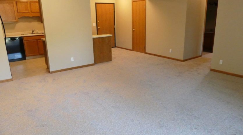 Regency Apartments in Huron, SD - Living Room and Kitchen