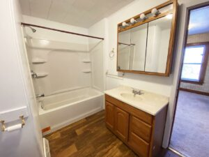 208 W Beebe Ave in Chamberlain, SD - Bathroom Vanity and Bathtub and Shower