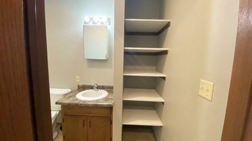 Bluestem Apartments in Canistota, SD - 1 Bedroom Apartment Bathroom Storage