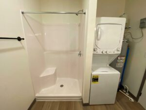Flats on 8th in Watertown, SD - Studio Apartment Shower and Laundry