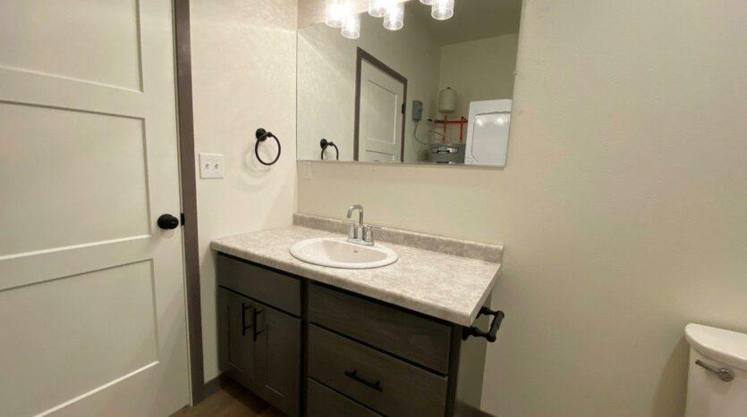 Flats on 8th in Watertown, SD - Studio Apartment Bathroom Vanity