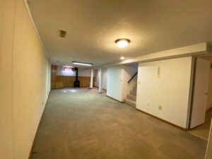 813 NE 8t Street in Madison, SD - Downstairs Living Room