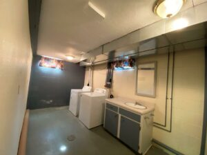 813 NE 8t Street in Madison, SD - Downstairs Laundry and Bathroom
